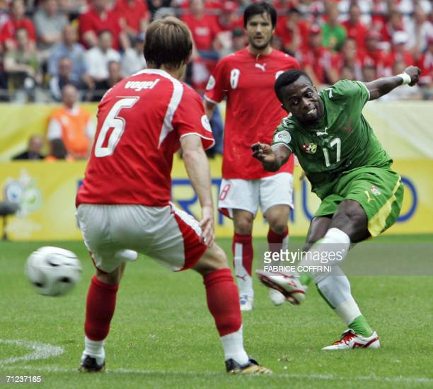 Togolese forward Mohamed Kader shoots past Swiss midfielder Johann Vogel in the opening round Group G World Cup football match Togo vs. Switzerland,...