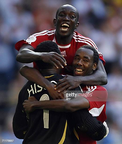 Trinidad and Tobago's forward Dwight Yorke and teammates celebrate at the end of the 2006 World Cup group B football game Trinidad and Tobago vs...