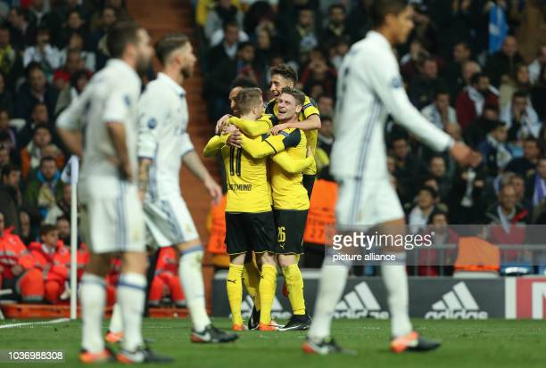 Dortmund goalscorer Marco Reus celebrates his equalizer goal at 2:2 with Lukasz Piszczek during the Champions League football match between Real...