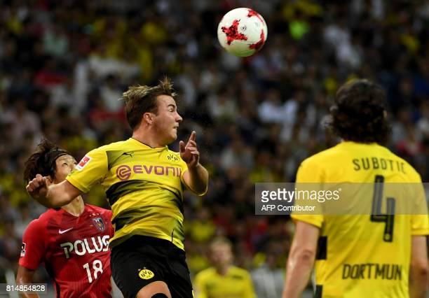 Dortmund midfielder Mario Gotze clears the ball during their friendly football match between Japan's Urawa Reds and Germany's Borussia Dortmund at...