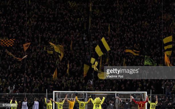 Dortmund players acknowledge the fans after the Bundesliga match between Borussia Dortmund and Borussia Moenchengladbach at Signal Iduna Park on...