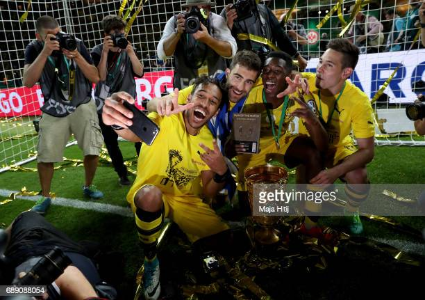 Dortmund players celebrate taking a selfie with the trophy after winning the DFB Cup final match between Eintracht Frankfurt and Borussia Dortmund at...