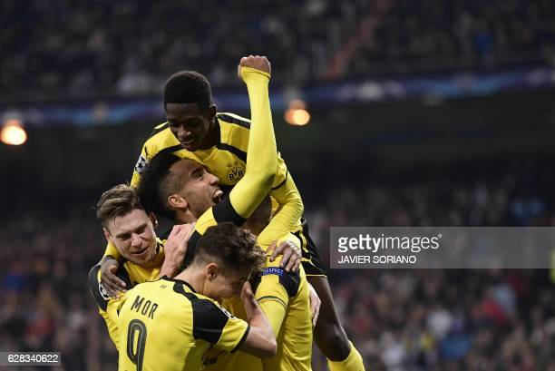 TOPSHOT Dortmund players celebrate their second goal during the UEFA Champions League football match Real Madrid CF vs Borussia Dortmund at the...