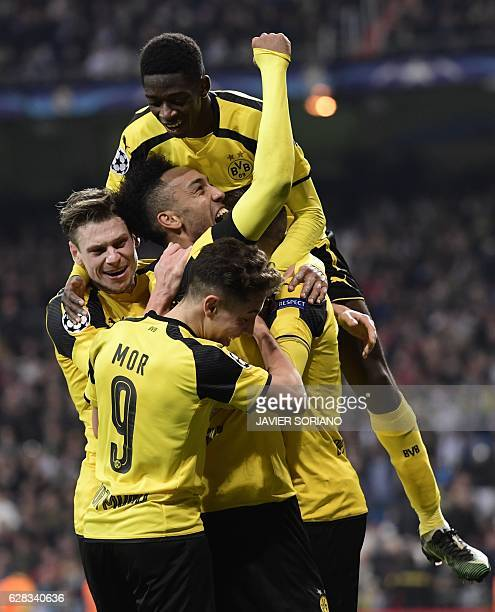 Dortmund players celebrate their second goal during the UEFA Champions League football match Real Madrid CF vs Borussia Dortmund at the Santiago...