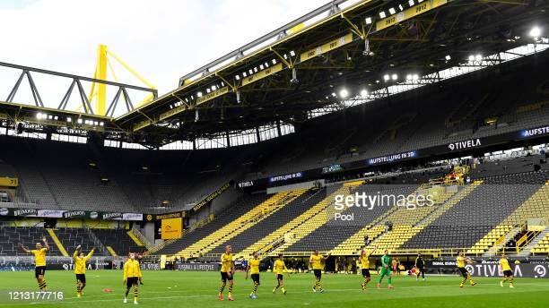 Dortmund players celebrate victory during the Bundesliga match between Borussia Dortmund and FC Schalke 04 at Signal Iduna Park on May 16, 2020 in...