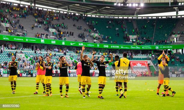Dortmund players celebrate victory with their fans after the German First division Bundesliga football match VfL Wolfsburg v BVB Borussia Dortmund in...