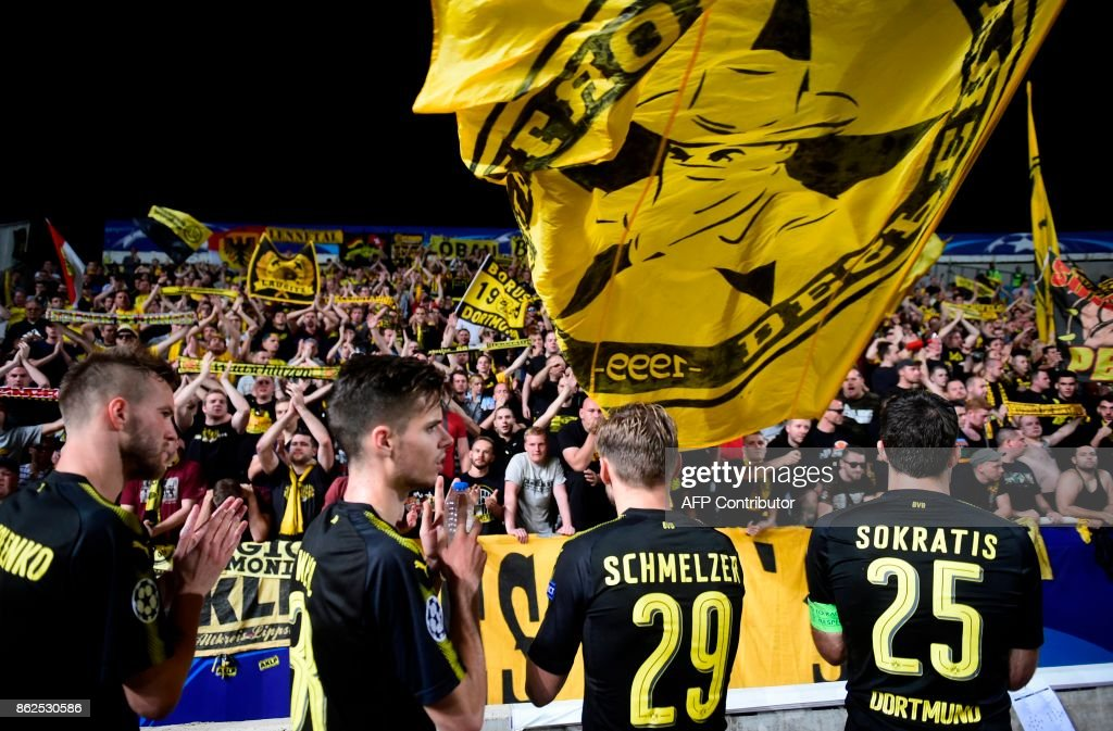 Dortmund players congratulate their supporters at the end of the UEFA Champions League football match between Apoel FC and Borussia Dortmund at the GSP Stadium in the Cypriot capital, Nicosia on October 17, 2017. /