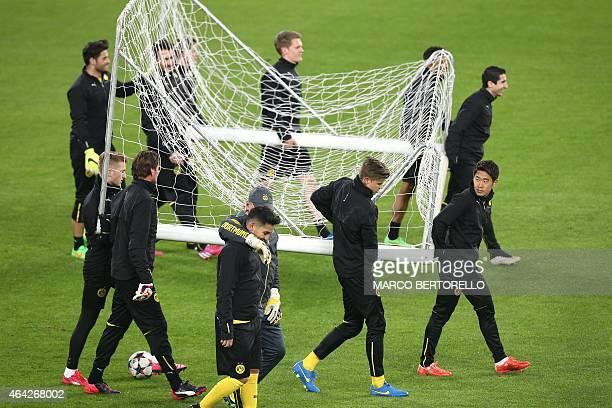 Dortmund players train on February 23 2015 in Turin on the eve of the last 16 firstleg UEFA Champions League football match Juventus vs Borussia...