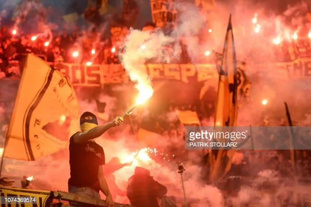Dortmund supporters burn fireworks during the German first division Bundesliga football match Fortuna Duesseldorf v Borussia Dortmund in Duesseldorf,...