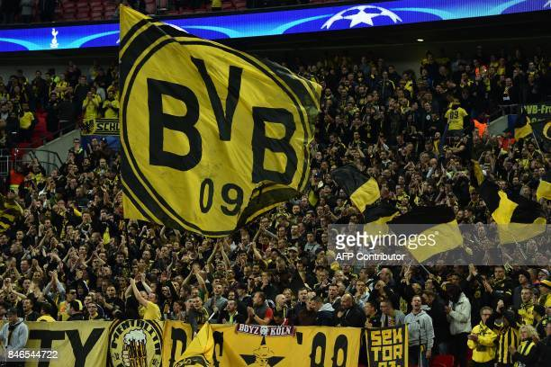 Dortmund supporters cheer on their team ahead of the UEFA Champions League Group H football match between Tottenham Hotspur and Borussia Dortmund at...