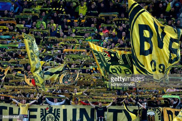 Dortmund supporters cheer on their team during the UEFA Champions League Group H football match between Tottenham Hotspur and Borussia Dortmund at...