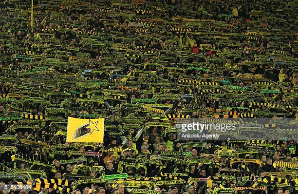 Dortmund supporters mourn after a fan passed away during the Bundesliga soccer match between Borussia Dortmund and FSV Mainz 05 at the SignalIduna...
