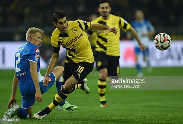 Dortmund's Armenian midfielder Henrikh Mkhitaryan and Hoffenheim's defender Andreas Beck vie for the ball during the German first division Bundesliga...