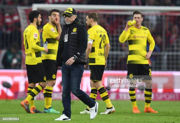 Dortmund's Austrian head coach Peter Stoeger leaves the pitch after the German first division Bundesliga football match FC Bayern Munich vs Borussia...