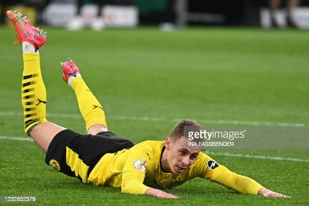 Dortmund's Belgian forward Thorgan Hazard celebrates scoring the 4-0 during the German Cup semi-final football match BVB Borussia Dortmund v Holstein...