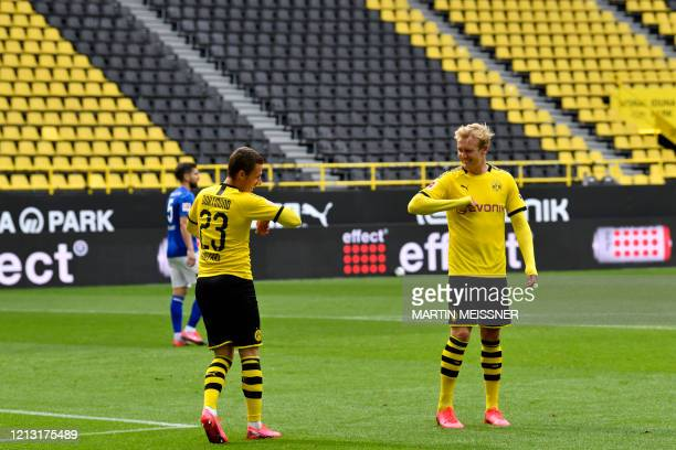 Dortmund's Belgian forward Thorgan Hazard celebrates with Dortmund's German forward Julian Brandt after scoring his side's third goal during the...