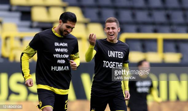 """Dortmund's Belgian forward Thorgan Hazard wears a """"United Together"""" T-Shirt in solidarity with protests raging across the US over the death of George..."""