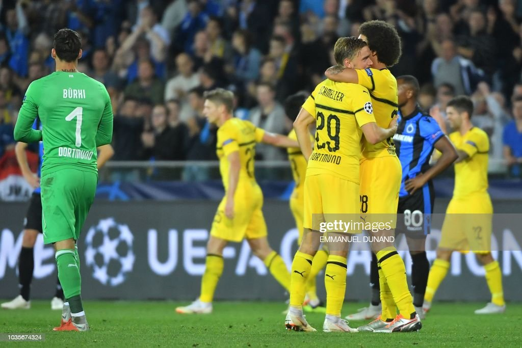 Dortmund's Belgian midfielder Axel Witsel (R) and Dortmund's German defender Marcel Schmelzer celebrate their victory at the end the UEFA Champions League Group C football match Club Brugge vs Borussia Dortmund at the Jan Breydel stadium in Bruges on September 18, 2018.