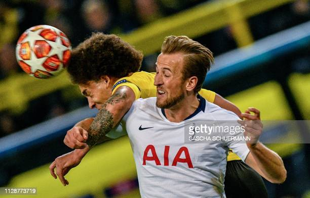 Dortmund's Belgian midfielder Axel Witsel and Tottenham Hotspur's English striker Harry Kane vie for the ball during the UEFA Champions League round...