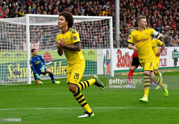 Dortmund's Belgian midfielder Axel Witsel celebrates after scoring the 10 during the German first division Bundesliga football match SC Freiburg vs...