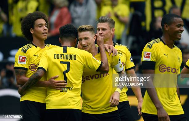 Dortmund's Belgian midfielder Axel Witsel Dortmund's English midfielder Jadon Sancho Dortmund's German forward Marco Reus and Dortmund's Polish...