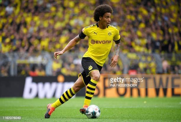 Dortmund's Belgian midfielder Axel Witsel runs with the ball during the German first division Bundesliga football match BVB Borussia Dortmund v...