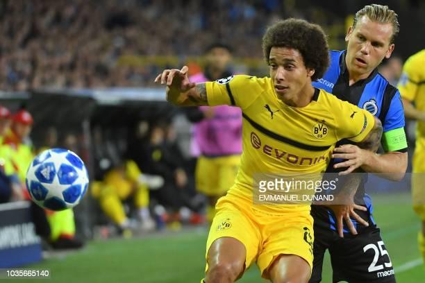 Dortmund's Belgian midfielder Axel Witsel vies with Club Brugge's Dutch midfielder Ruud Vormer during the UEFA Champions League Group C football...