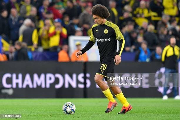 Dortmund's Belgian midfielder Axel Witsel warms up on the ball during the UEFA Champions League Group F football match Borussia Dortmund v FC...