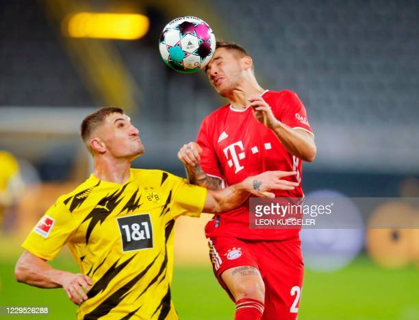 Dortmund's Belgian midfielder Thomas Meunier and Bayern Munich's French defender Lucas Hernandez vie for the ball during the German first division...