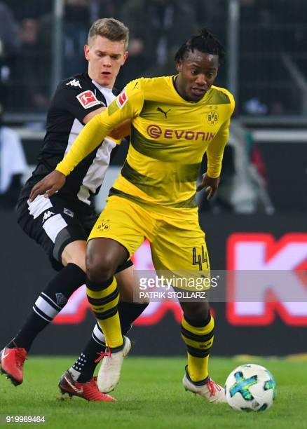Dortmund's Belgian striker Michy Batshuayi and Moenchengladbach's German defender Matthias Ginter vie for the ball during the German first division...