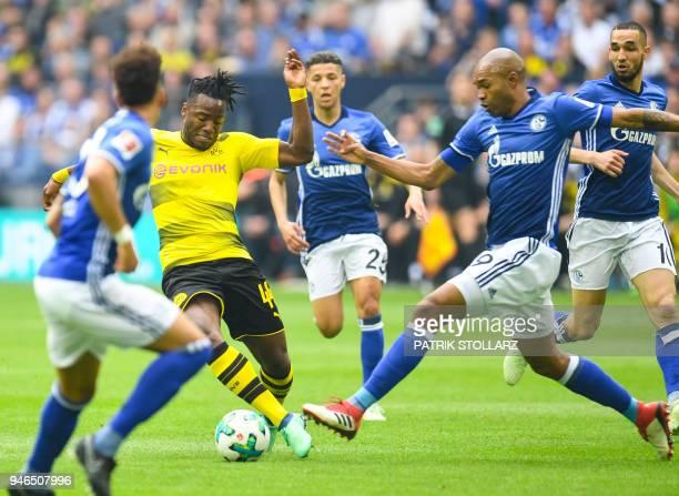 Dortmund's Belgian striker Michy Batshuayi and Schalke's Brazilian defender Naldo vie for the ball during the German first division Bundesliga...