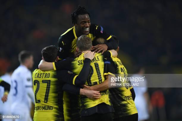 Dortmund's Belgian striker Michy Batshuayi celebrates with teammates Dortmund's German midfielder Gonzalo Castro Dortmund's German midfielder Andre...