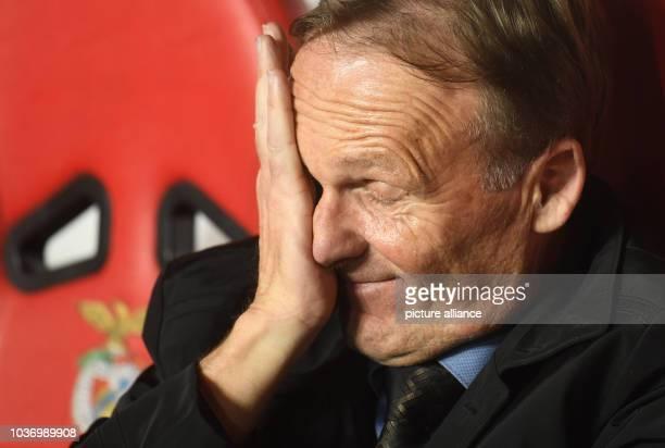 Dortmund's CEO HansJoachim Watzke rubs his eyes during the first leg of the Champions League quarter final knockout match between the Portuguese...