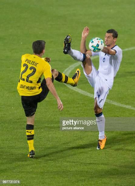 Dortmund's Christian Pulisic and Bergamo's Remo Freuler vie for the ball during the Borussia Dortmund vs Atalanta Bergamo test match in Altach...
