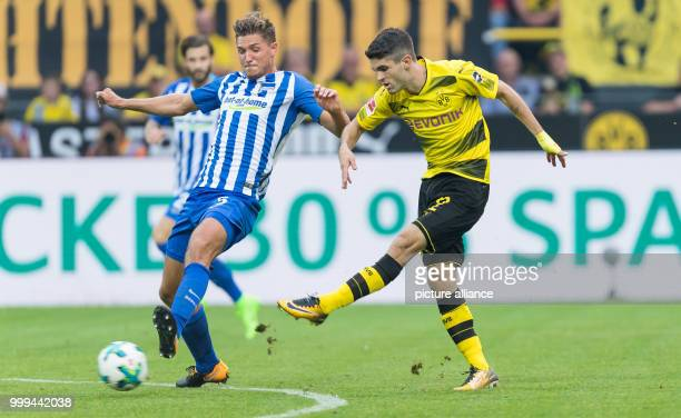 Dortmund's Christian Pulisic plays against Berlin's Niklas Stark during the Bundesliga soccer match between Borussia Dortmund and Hertha BSC Berlin...