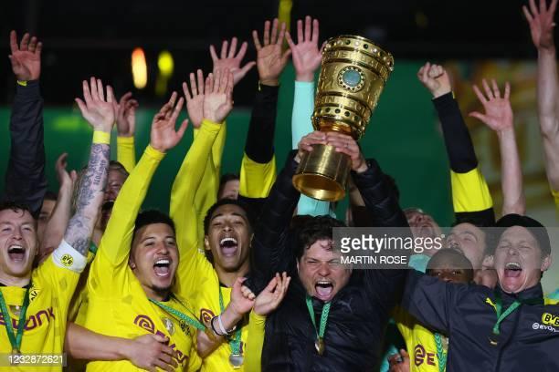 Dortmund's coach Edin Terzic celebrates with the trophy after winning the German Cup final football match RB Leipzig v BVB Borussia Dortmund, in...