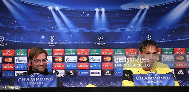 Dortmund's coach Jurgen Klopp and Gabonese midfielder PierreEmerick Aubameyang give a press conference on February 23 2015 on the eve of the last 16...