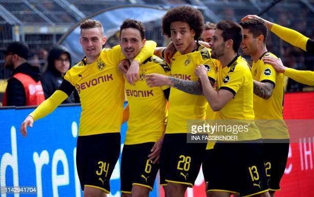 Dortmund's Danish forward Jacob Bruun Larsen Dortmund's Danish midfielder Thomas Delaney Dortmund's Belgian midfielder Axel Witsel Dortmund's...