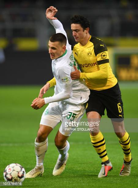 Dortmund's Danish midfielder Thomas Delaney and Bremen's German midfielder Maximilian Eggestein vie for the ball during the German first division...