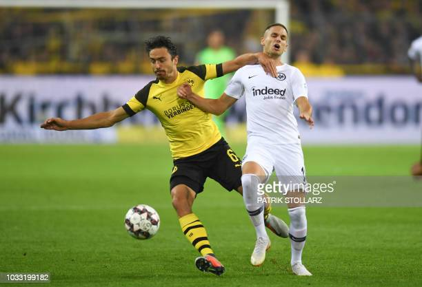 Dortmund's Danish midfielder Thomas Delaney and Frankfurt's Serbian midfielder Filip Kostic vie for the ball during the German first division...
