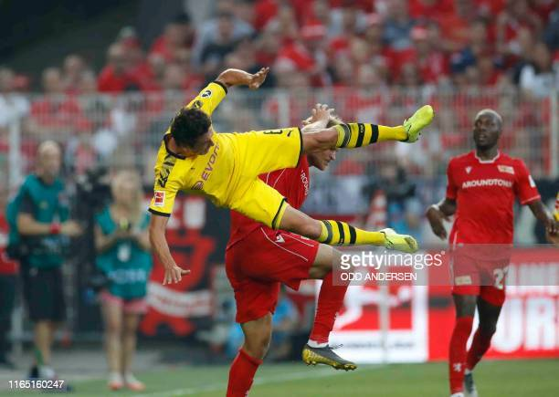 Dortmund's Danish midfielder Thomas Delaney and Union Berlin's Swedish forward Sebastian Andersson vie for the ball during the German first division...