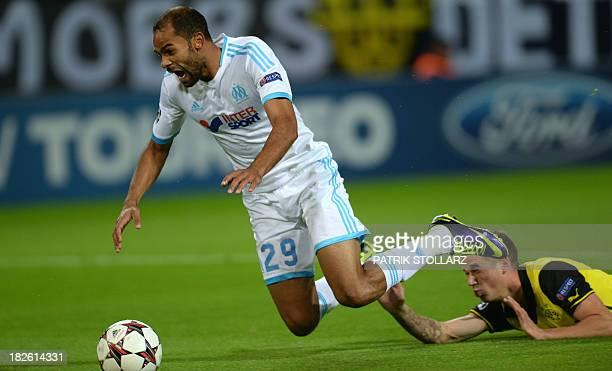 Dortmund's defender Eric Durm and Marseille's Tunisian forward Saber Khalifa vie for the ball during the UEFA Champions League Group F football match...