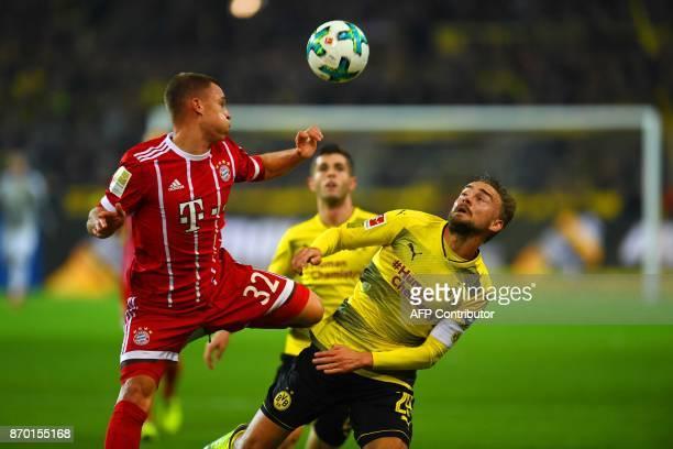 Dortmund's defender Marcel Schmelzer and Bayern Munich´s defender Joshua Kimmich vie for the ball during the German First division Bundesliga...