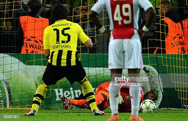 Dortmund's defender Mats Hummels fails to score a penalty against Ajax Amsterdam's goalkeeper Kenneth Vermeer during the UEFA Champions League group...