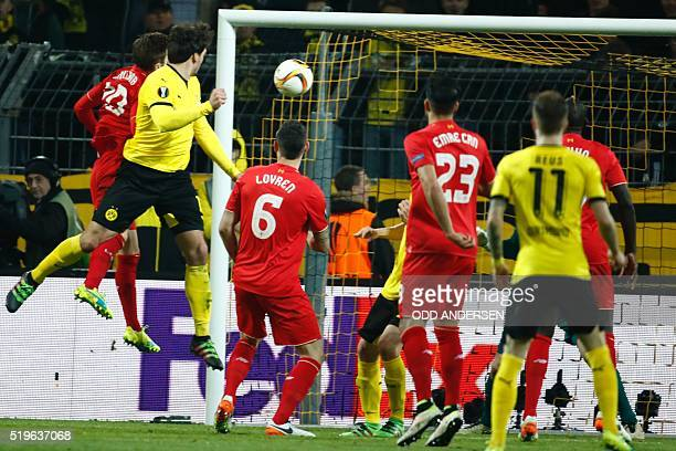 Dortmund's defender Mats Hummels scores the 11 equalizer during the UEFA Europe League quarterfinal firstleg football match Borussia Dortmund vs...