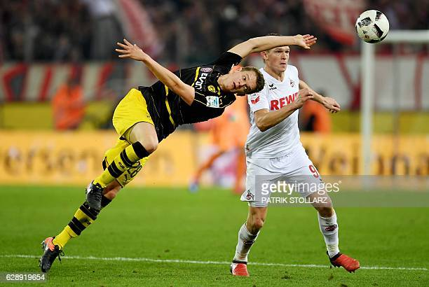 Dortmund's defender Matthias Ginter and Cologne's Latvian striker Artjoms Rudnevs vie for the ball during the German first division Bundesliga...