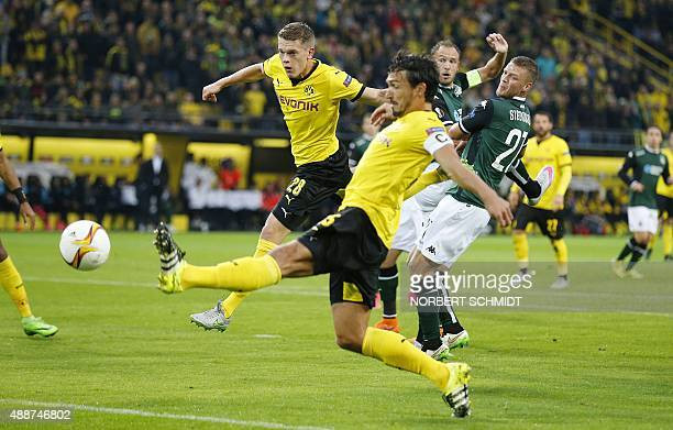 Dortmund's defender Matthias Ginter and Dortmund's defender Mats Hummels vie for the ball with Krasnodar's defender from Iceland Ragnar Sigurdsson...