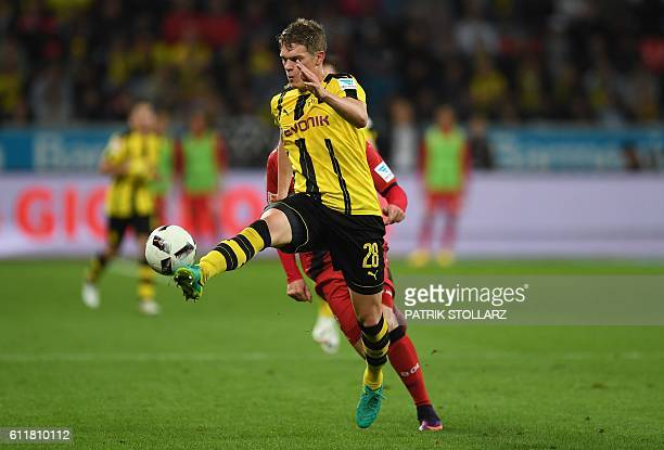Dortmund's defender Matthias Ginter and Leverkusen's midfielder Julian Brandt vie for the ball during the German first division Bundesliga football...