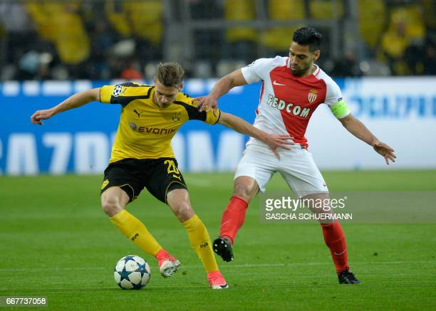 Dortmund's defender Matthias Ginter vies for the ball with Monaco's Colombian forward Radamel Falcao during the UEFA Champions League 1st leg...