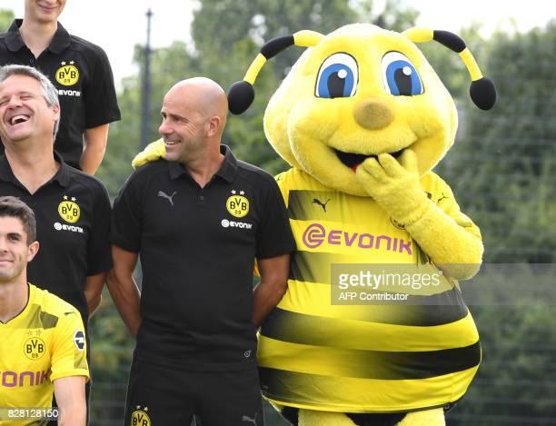 Dortmund's Dutch head coach Peter Bosz and the club's mascot Emma pose for a team photo of German first division Bundesliga football club Borussia...